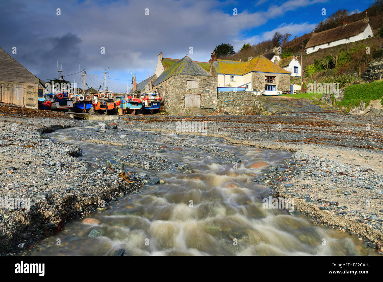 The stream on the shingle beach at Cadgwith Cove in Cornwall - Stock Image