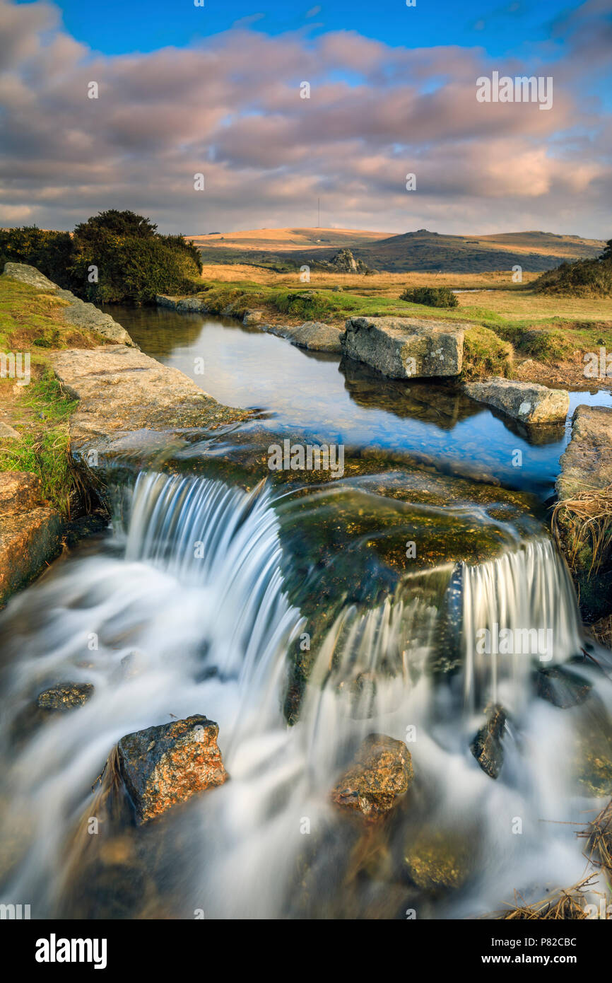 A waterfall on the Devonport Leat captured at Windy Post in the Dartmoor National Park. - Stock Image