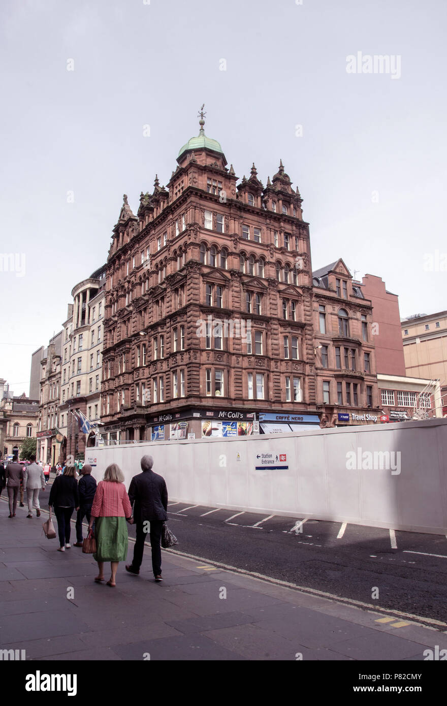 GLASGOW, SCOTLAND - JUNE 23rd 2018: A Glasgow Victorian building next to the £100 million redevelopment of the Glasgow Queen Street train station. - Stock Image