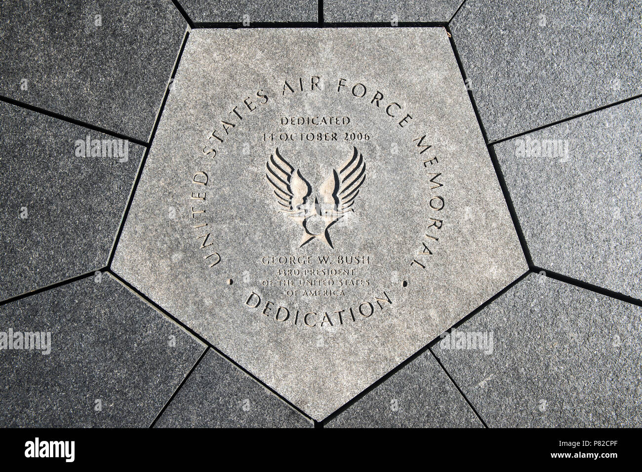 ARLINGTON, Virginia, USA - A foundation stone in the center of the US Air Force Memorial in Washington DC. It references the memorial's dedication by President George W. Bush on 14 October 2006. - Stock Image