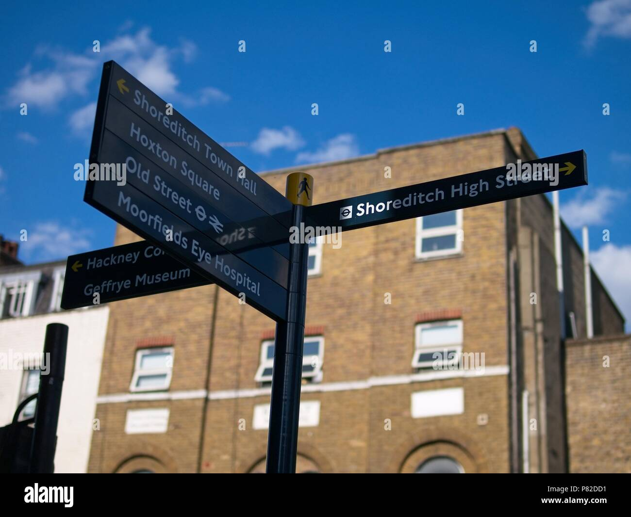 London, UK - July 07 2018: Tourist sign on the street, indicating directions to different places in Shoreditch area. - Stock Image
