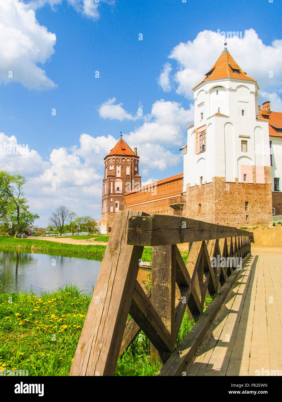 Mir, Belarus. Castle Complex Mir On Sunny Day with blue sky Background. Old medieval Towers and walls of traditional fort from unesco world heritage list - Stock Image