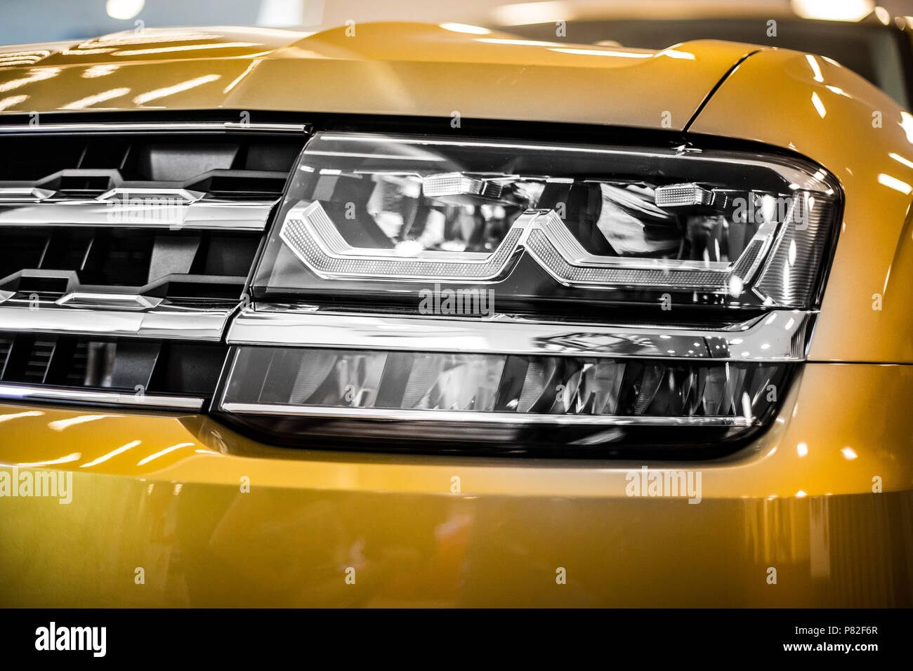 headlight of large SUV modern car with led and xenon optics - Stock Image