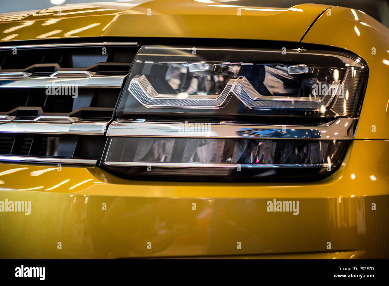headlight of modern yellow car with led and xenon optics - Stock Image