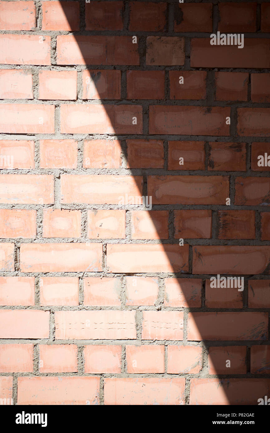 Brick wall with shadow pattern texture background - Stock Image