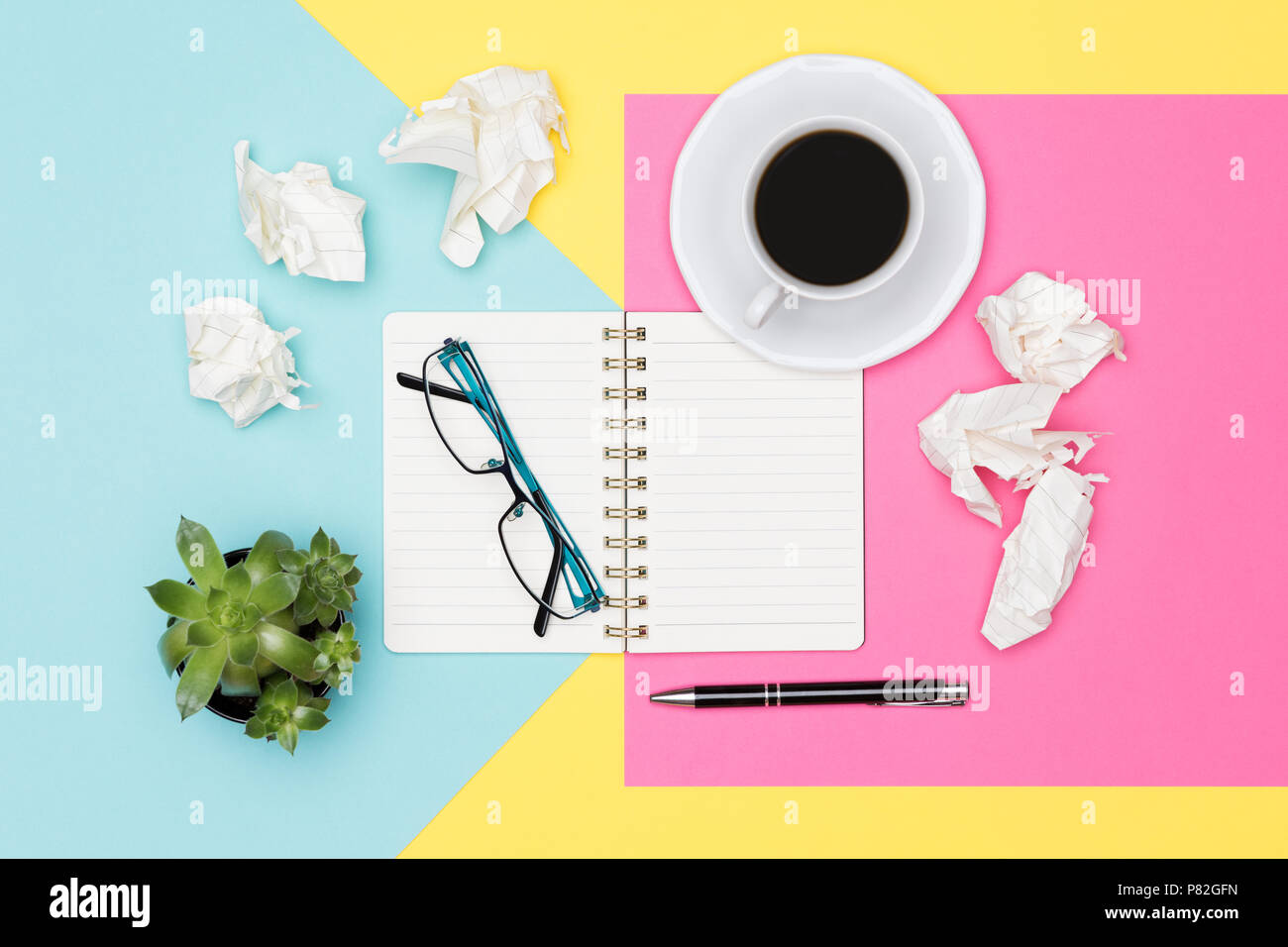 Writer's block. Ideas, brainstorming, creativity, deadline, frustration concept. Top view photo of office desk with blank mock up open note pad. - Stock Image