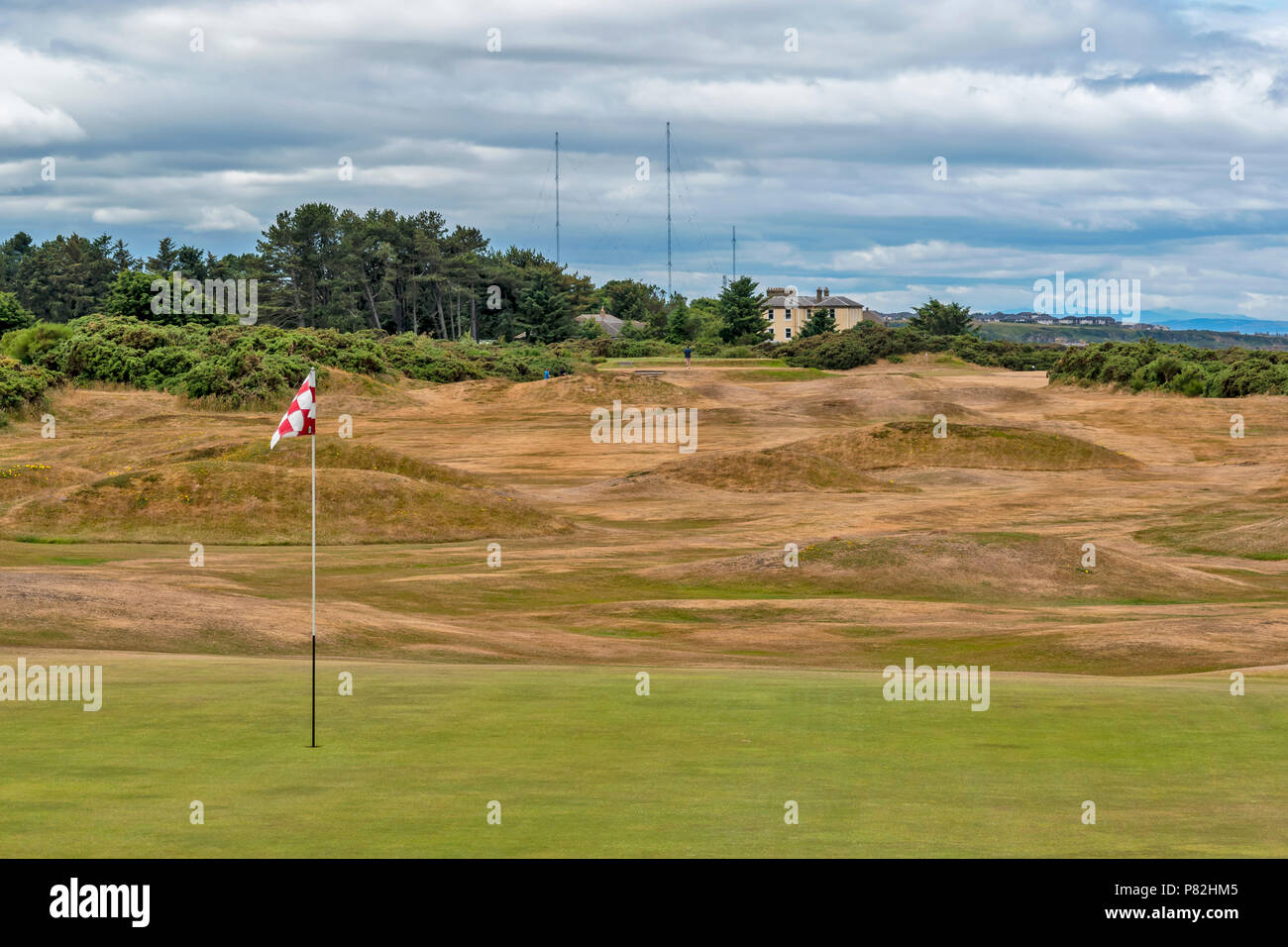 HOPEMAN MORAY SCOTLAND GOLFERS ON A VERY DRY GOLF COURSE DUE TO HOT SUMMER AND LACK OF WATER - Stock Image