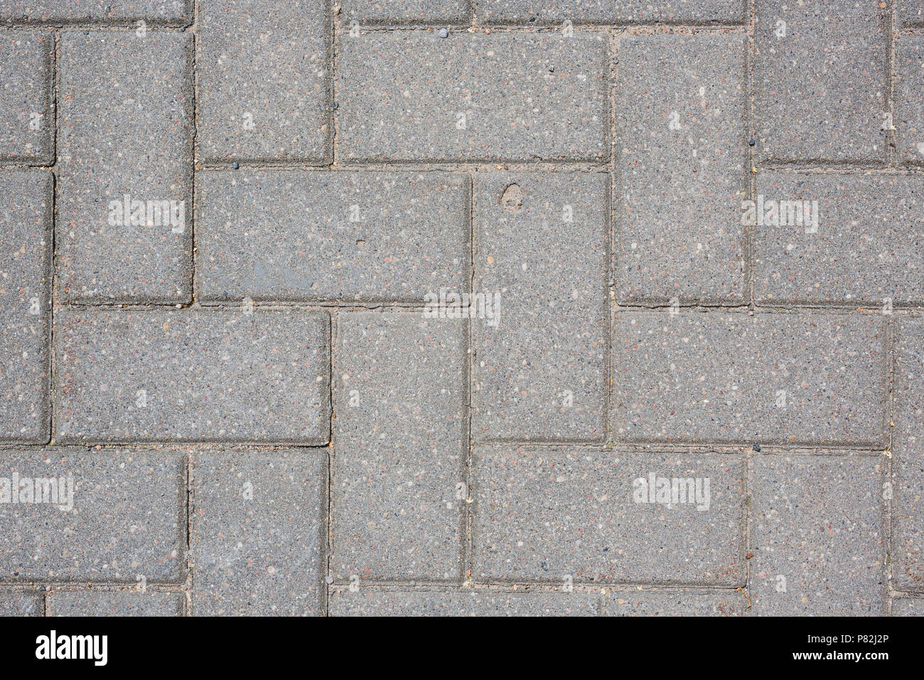 concrete tile on the ground pavement path abstract pattern texture background top shot Stock Photo