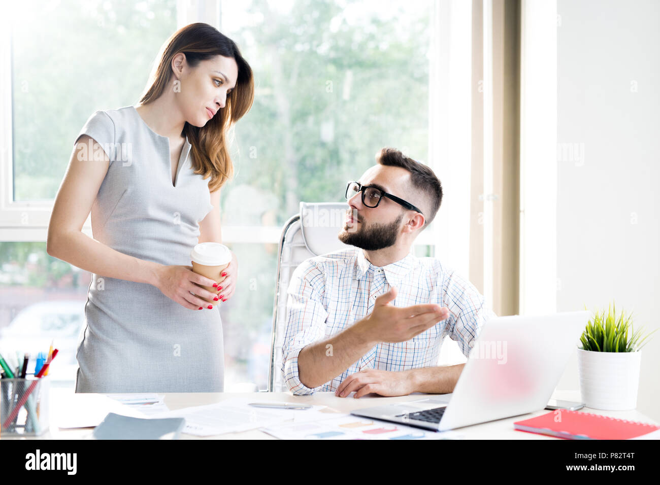 Two Business Managers Discussing Work - Stock Image