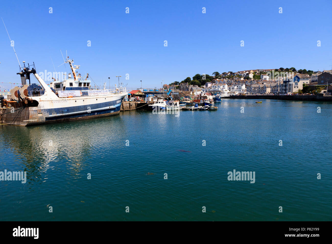 Offshore trawler Accumulate carrying Brexit fisheries protest banners in Brixham harbour, Devon, UK - Stock Image