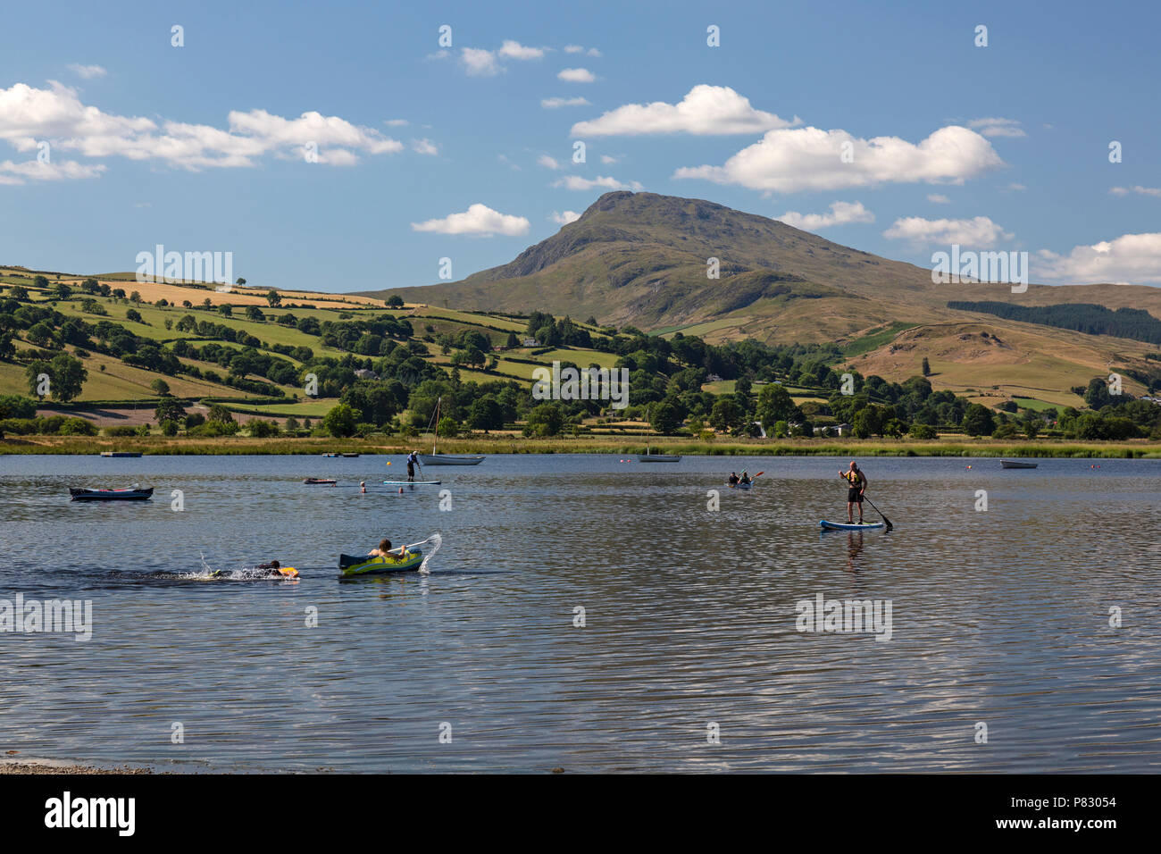 People taking part in various watersports on Lake Bala, or Llyn Tegid in Gwynedd, mid Wales, UK. - Stock Image