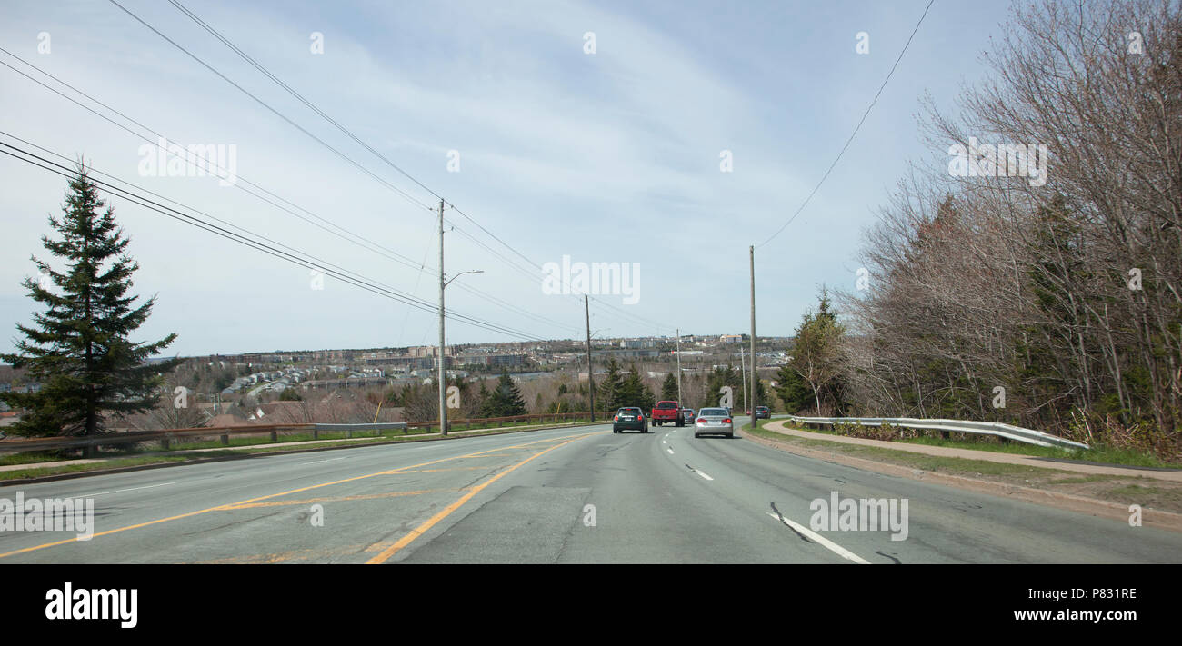 May 12, 2018- Dartmouth, Nova Scotia: Cars driving down the corner of Breakhart Hill, an affectionate name for the steep section of Cole Harbour Drive - Stock Image