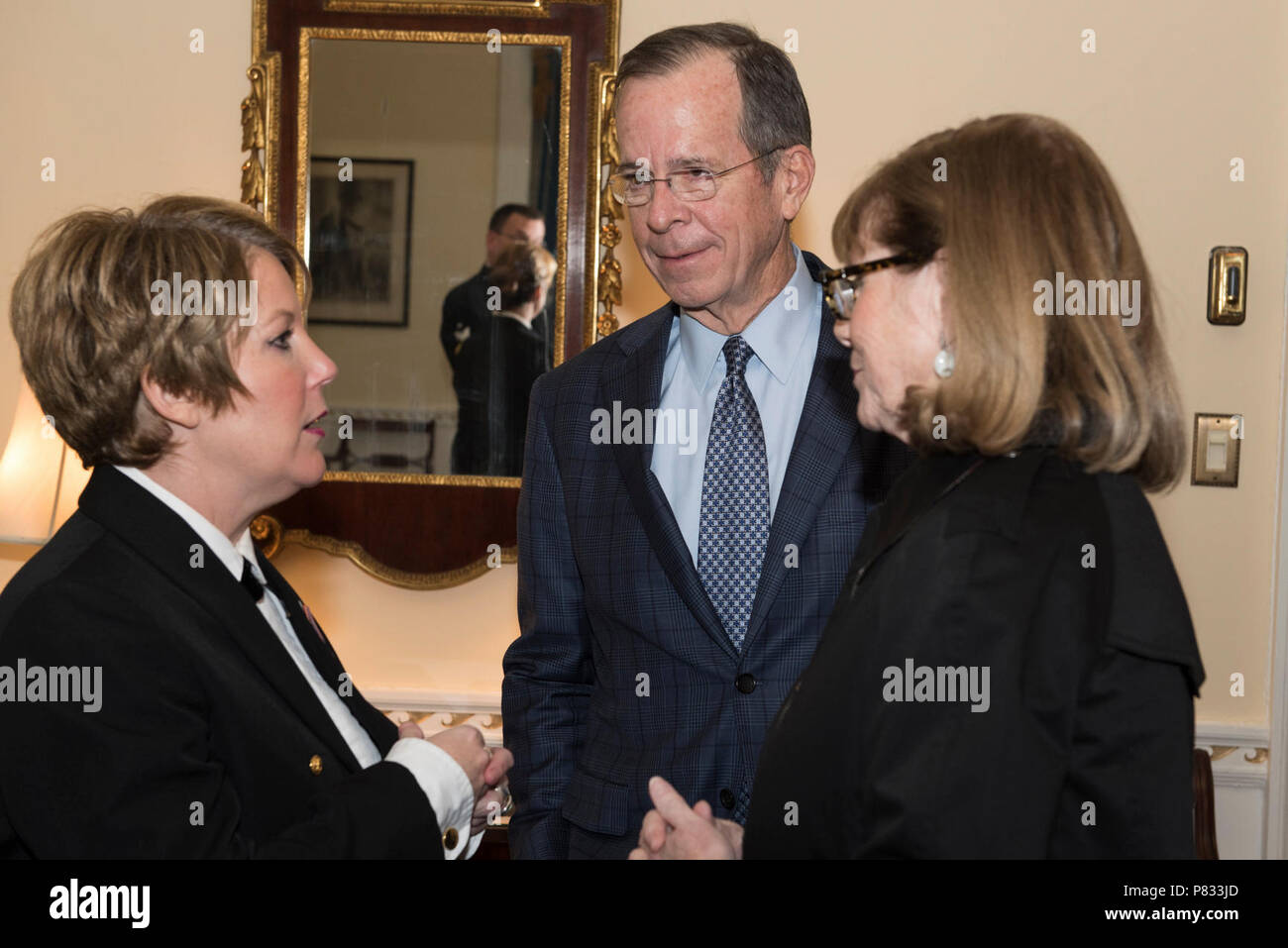 WASHINGTON (Dec. 18, 2016) Chief Petty Officer Shana Sullivan, left, meets former Chairman of the Joint Chiefs of Staff, Adm. Michael Mullen, right, backstage after the Sunday afternoon Navy Band Holiday Concert held at DAR Constitiution Hall in Washington, D.C. The Navy Band hosted thousands of people from the Washington area as well as hundreds of senior Navy and government officials during its three annual holiday concerts. - Stock Image