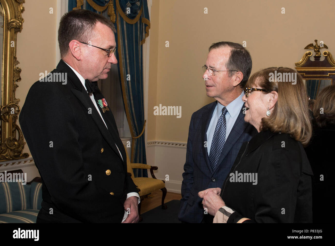 WASHINGTON (Dec. 18, 2016) Senior Chief Petty Officer Keith Arneson, left, meets former Chairman of the Joint Chiefs of Staff, Adm. Michael Mullen and his wife, right, backstage after the Sunday afternoon Navy Band Holiday Concert held at DAR Constitiution Hall in Washington, D.C. The Navy Band hosted thousands of people from the Washington area as well as hundreds of senior Navy and government officials during its three annual holiday concerts. - Stock Image