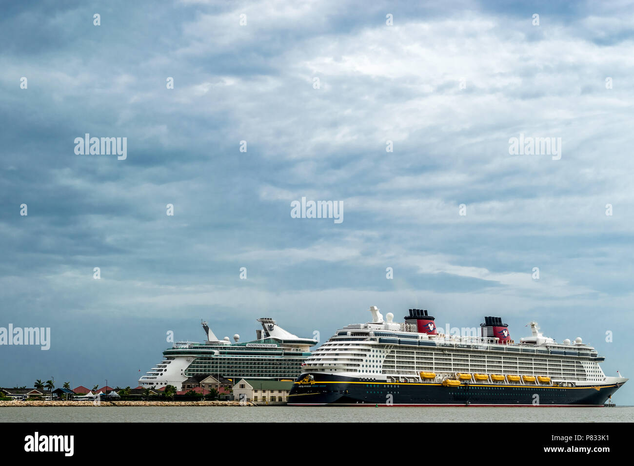 Falmouth, Jamaica - June 03 2015: Disney Fantasy and Royal Caribbean Independence of the Seas cruise ships docked side by side at the Falmouth Cruise - Stock Image