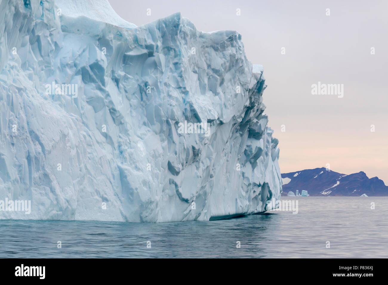 Greenlandic iceberg off the coast of Eastern Greenland - Stock Image