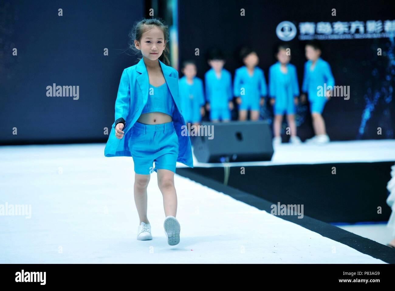 Qingdao, Qingdao, China. 9th July, 2018. Qingdao, CHINA-A kids' fashion show is held in Qingdao, east China's Shandong Province. Credit: SIPA Asia/ZUMA Wire/Alamy Live News - Stock Image