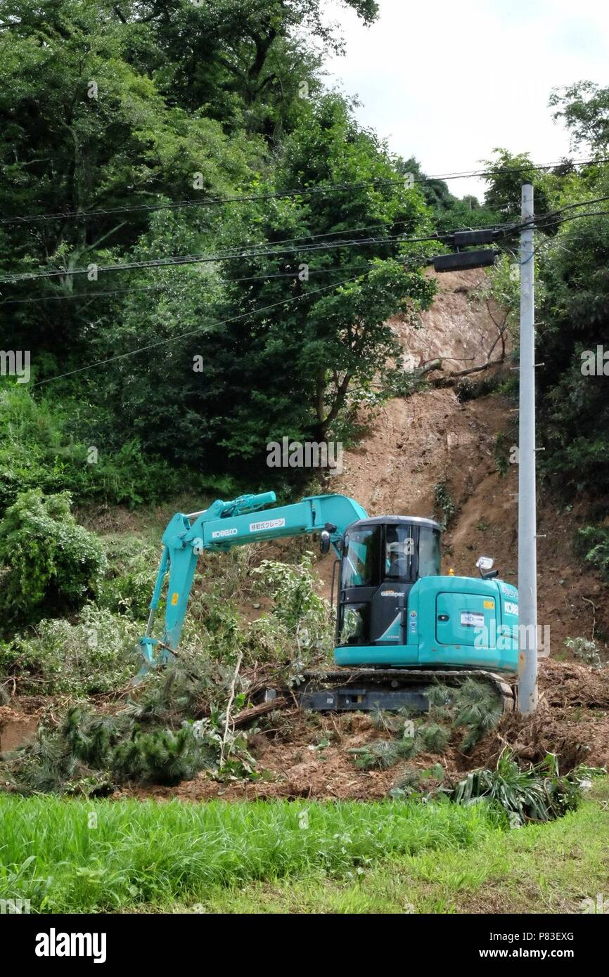 June 8, 2018. Earth movers work to clean up landslides in Hojo, Ehime, Shikoku, that have destroyed homes and closed roads. Record rainfall has caused landslides all over western Japan. Credit: Rod Walters/AFLO/Alamy Live News - Stock Image