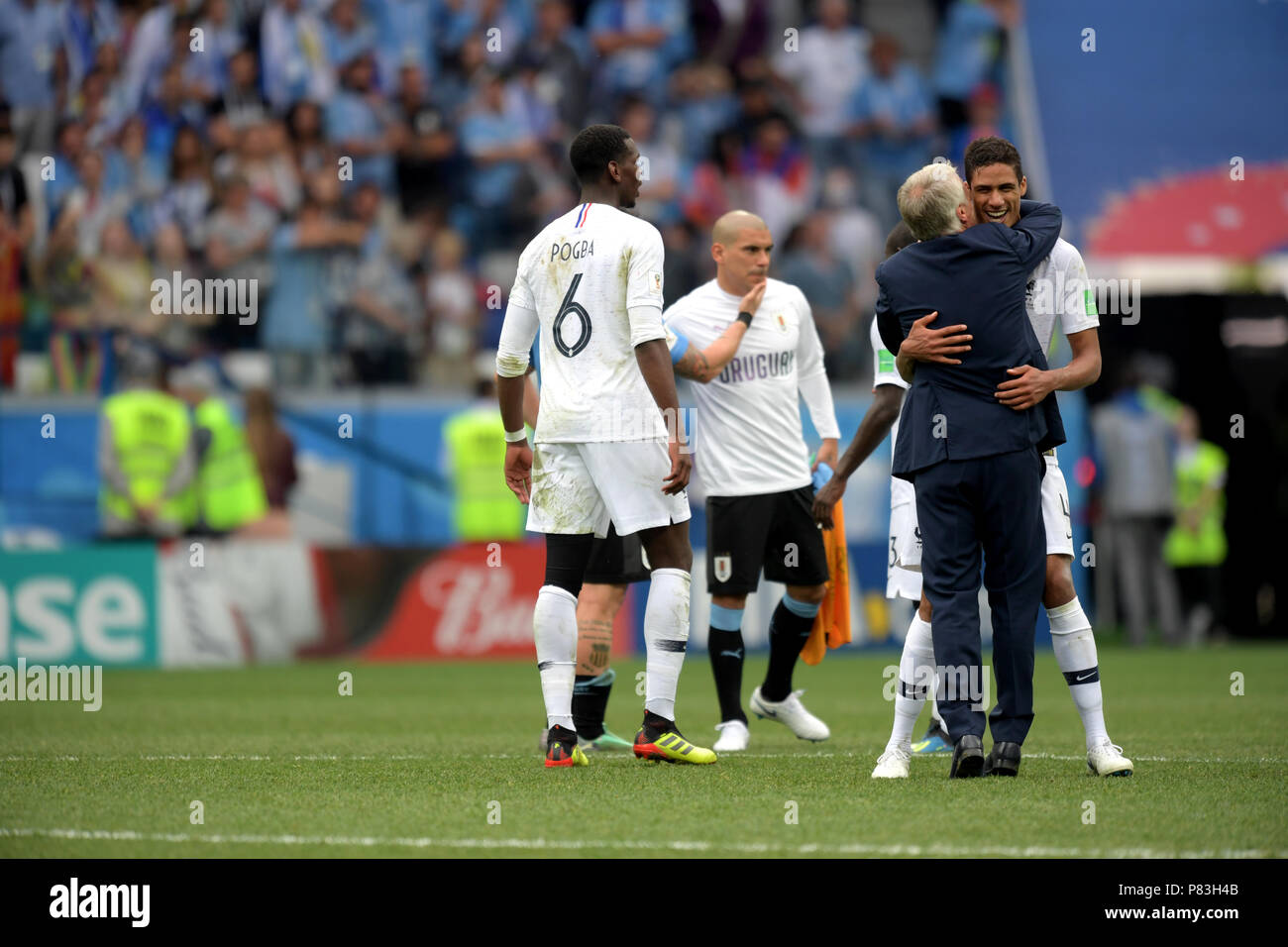 a8deb800bb French coach Didier Deschamps (FRA) hugs Raphael Varane as Paul Pogba (6)