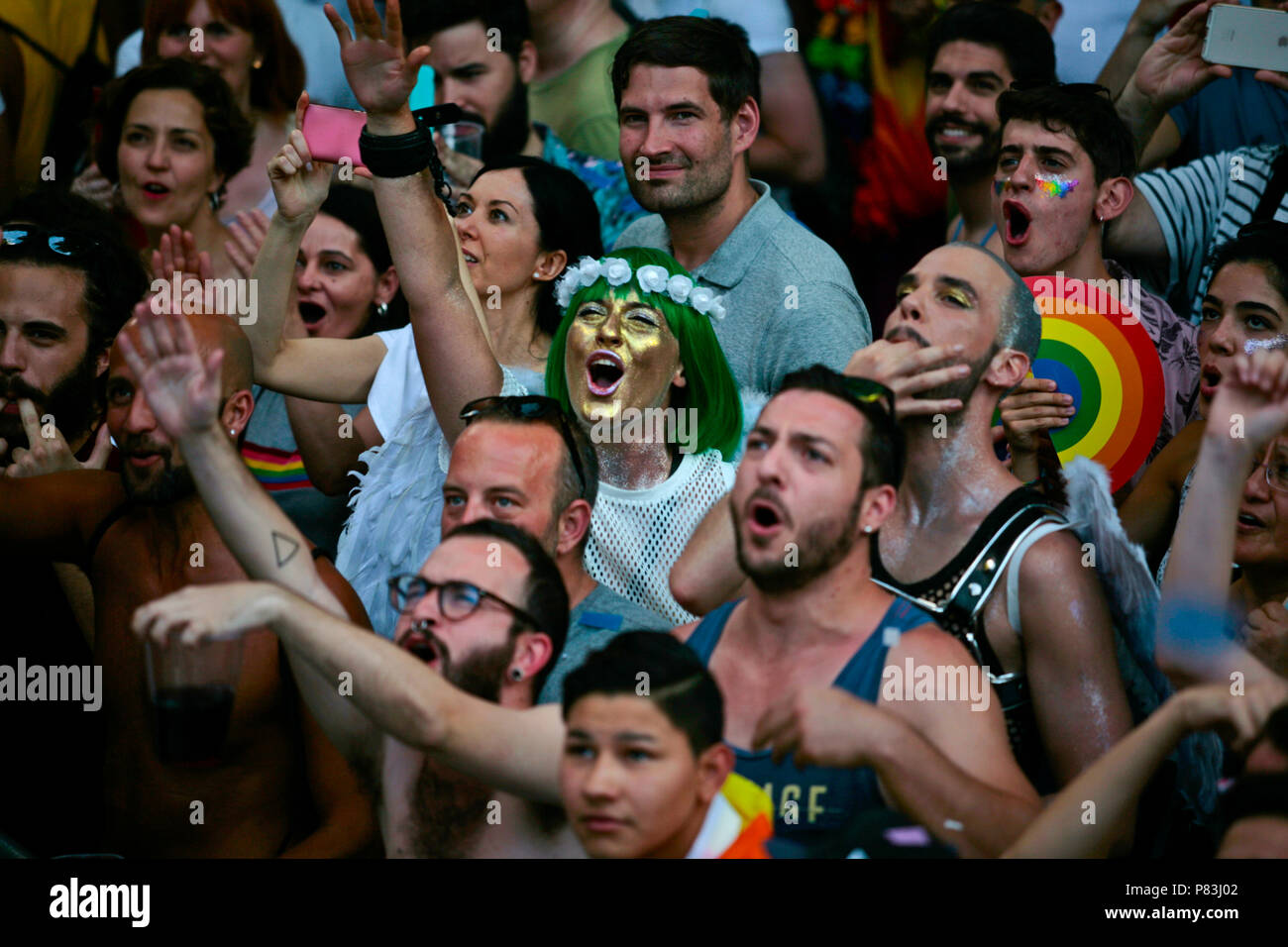 People seen enjoying the music during the 2018 Pride Parade. Thousands of people has been filling the streets and avenues of Madrid on a sunny day for the 2018 gay pride parade after still struggling for gay rights around the world. - Stock Image