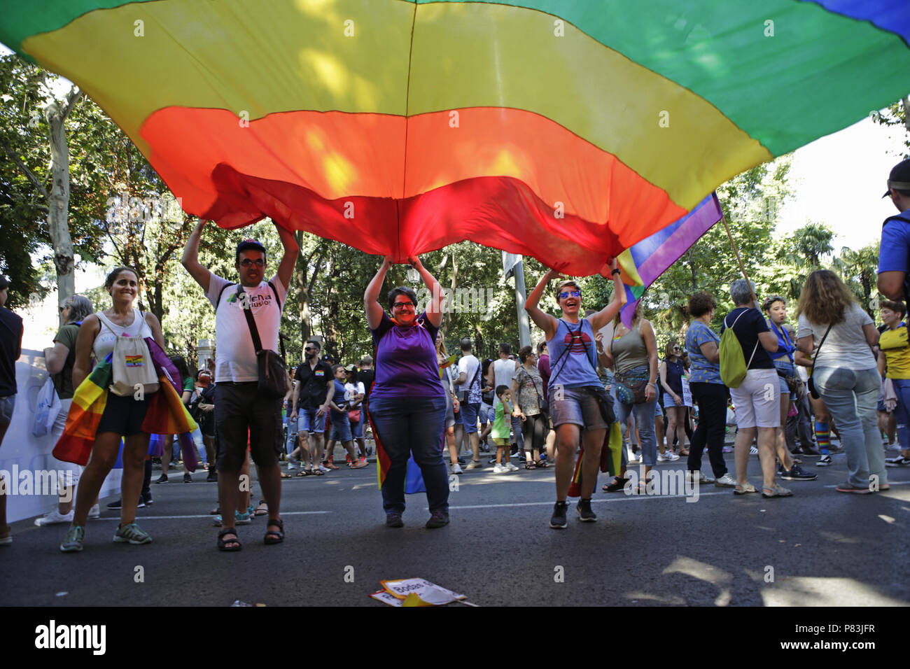 July 7, 2018 - Madrid, Spain - Multicolor flag, symbol of the LGTBI seen being carried by a group of peopla during the 2018 Pride Parade..Thousands of people has been filling the streets and avenues of Madrid on a sunny day for the 2018 gay pride parade after still struggling for gay rights around the world. (Credit Image: © Mario Roldan/SOPA Images via ZUMA Wire) - Stock Image