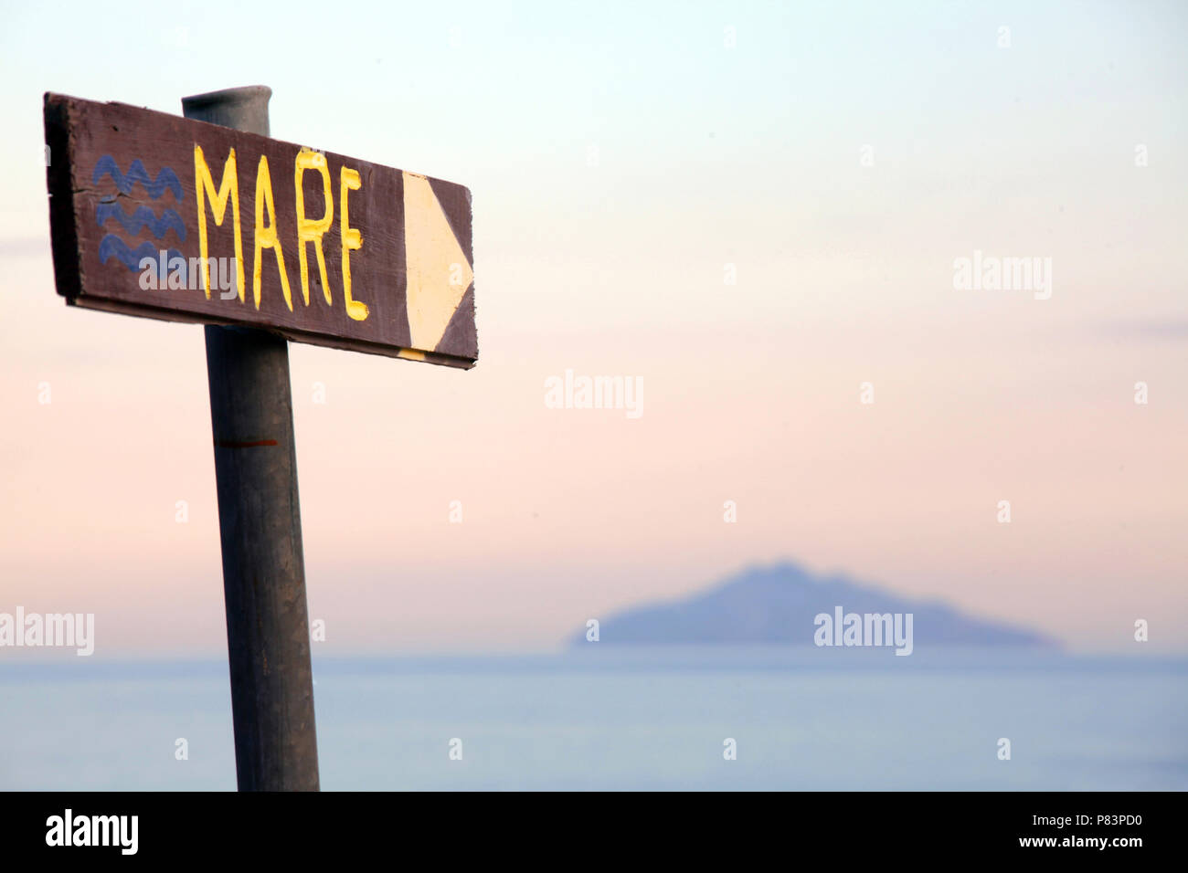 Wooden Italian beach sign pointing towards Elba, Tuscany, Italy, Europe Stock Photo