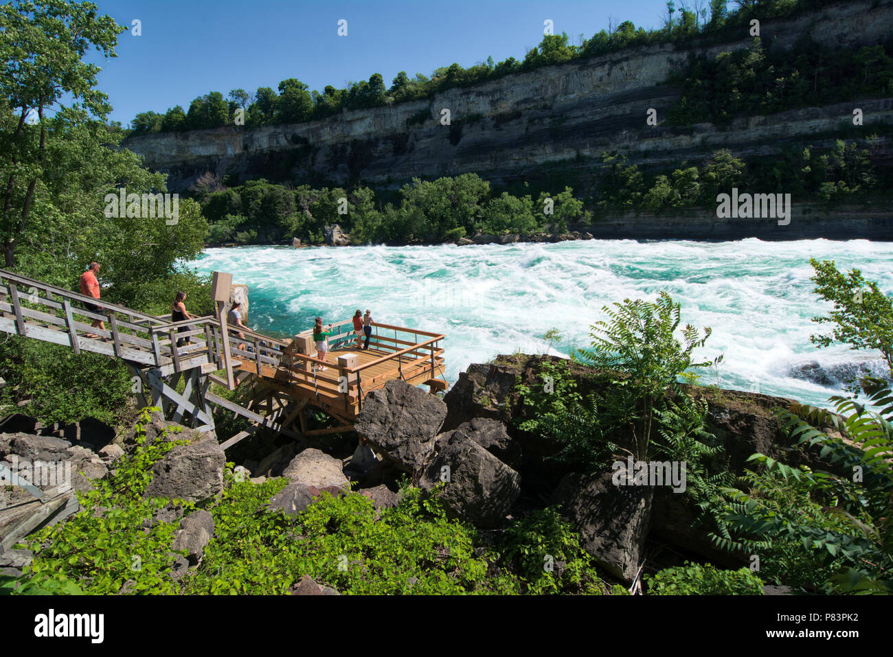 the Niagara River's Class 6 white-water rapids as seen from the White Water Walk attraction in the Niagara Gorge at Niagara Falls, Ontario, Canada - Stock Image