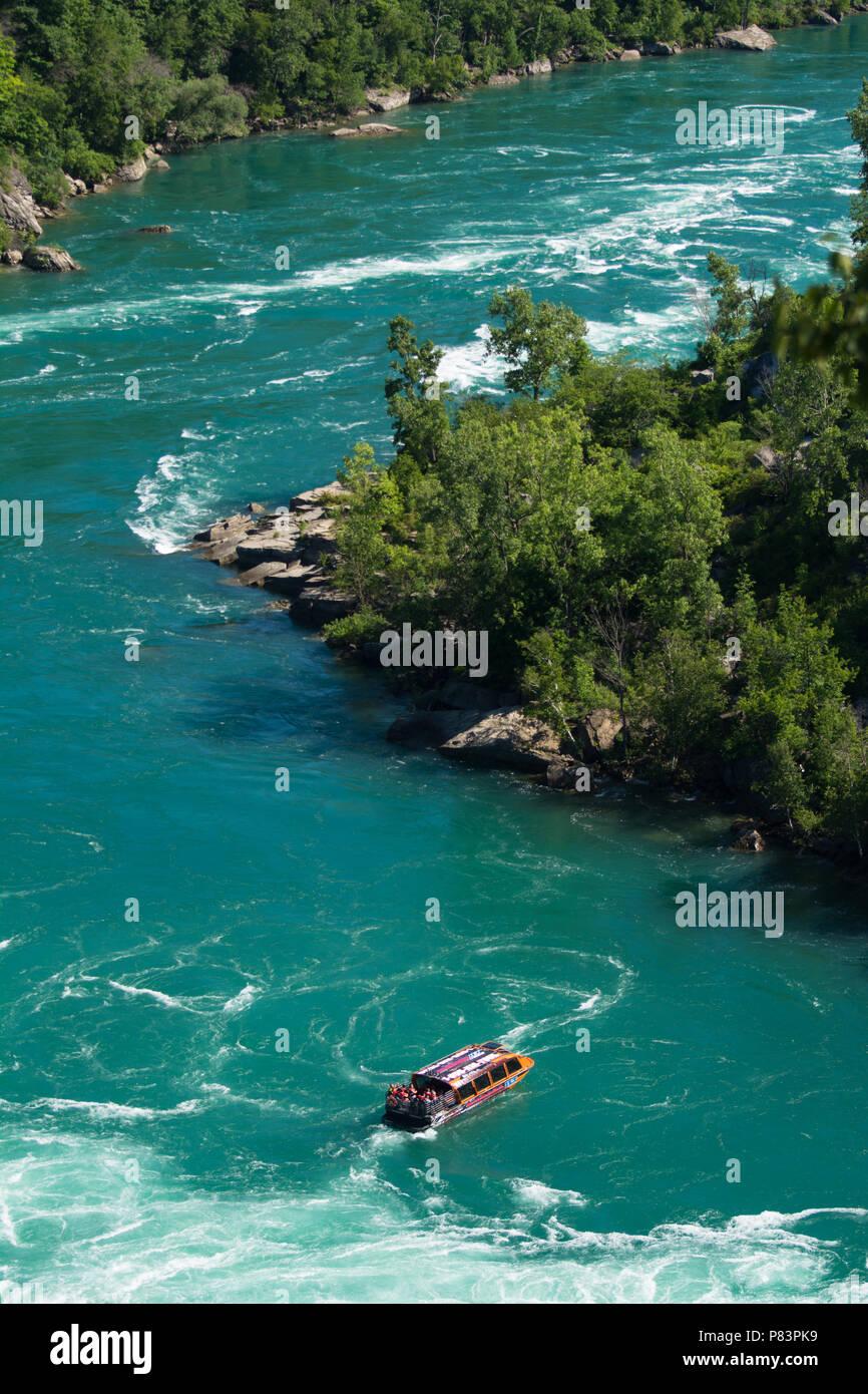 Whirlpool Jet Boat tour on the Niagara River in Niagara Gorge, Niagara Falls, Ontario, Canada - Stock Image