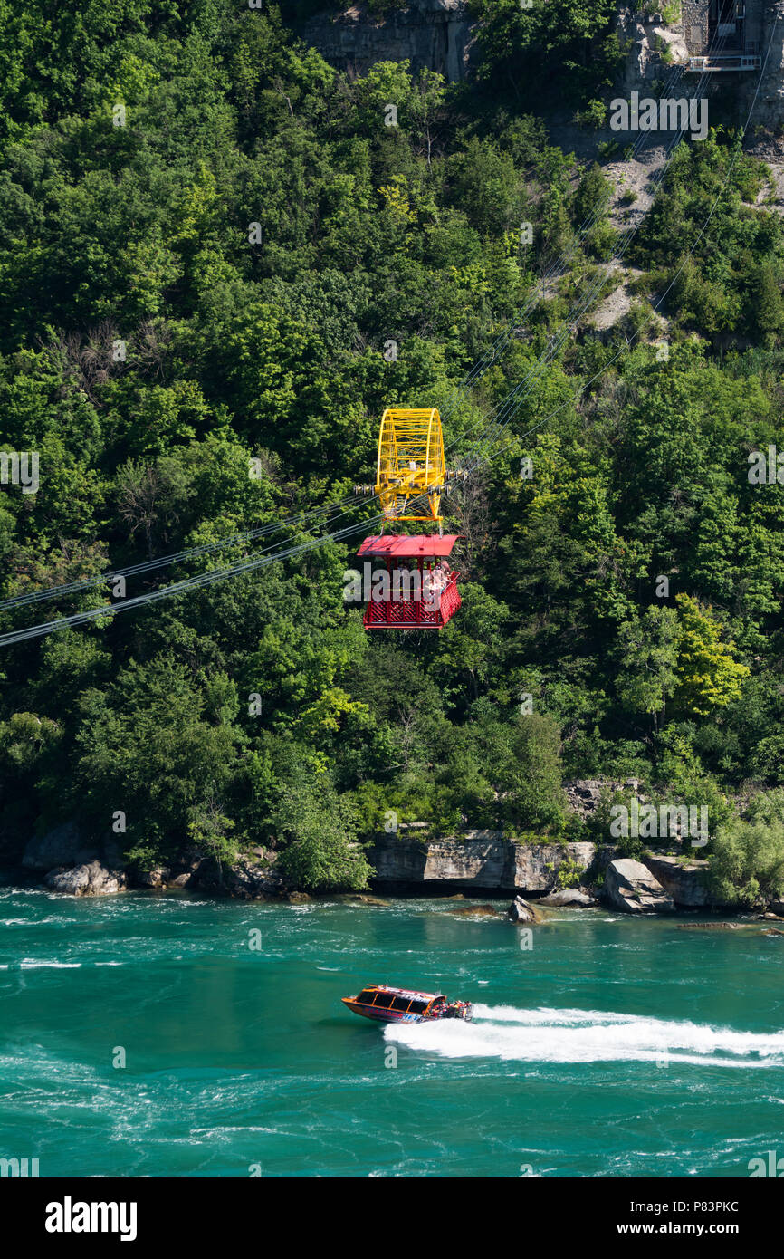 Aero car at the Whirpool Aero Car attraction passing over the roaring whirlpool rapids of the Niagara River - Niagara Falls, Ontario, Canada - Stock Image