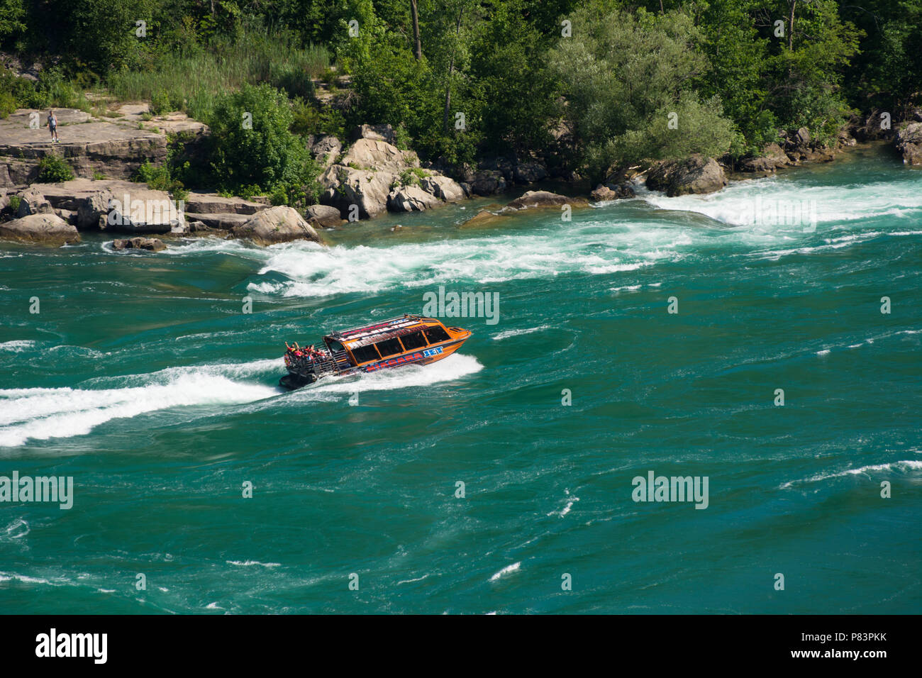 Whirlpool Jet Boat tour on the Niagara River in Niagara Gorge, Niagara Falls, Ontario, Canada - Stock Image