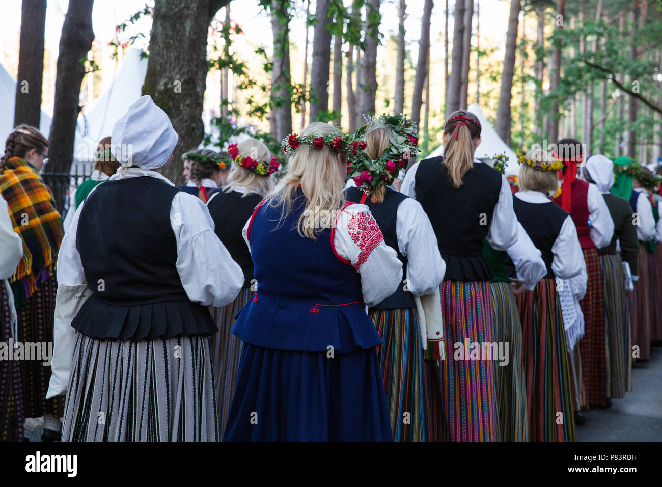 City Riga, Latvia. Choral Festival, singers at street, national costume and culture. Travel photo 2018. - Stock Image