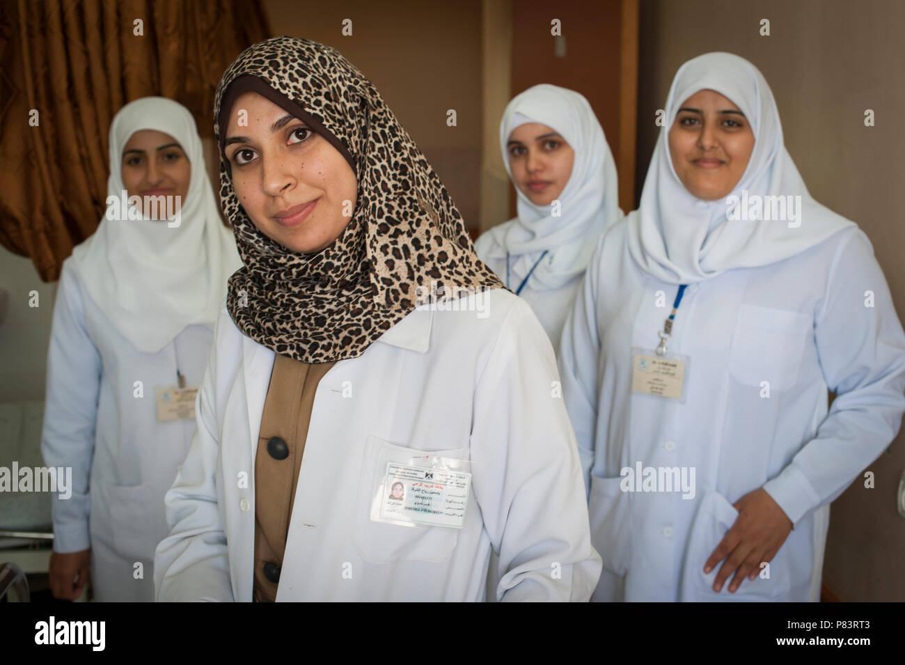 Working women in Islam Dr Yasmine Rabah Al Shorafa accompanied by nursing staff from the al Shifa Hospital, Gaza City. - Stock Image