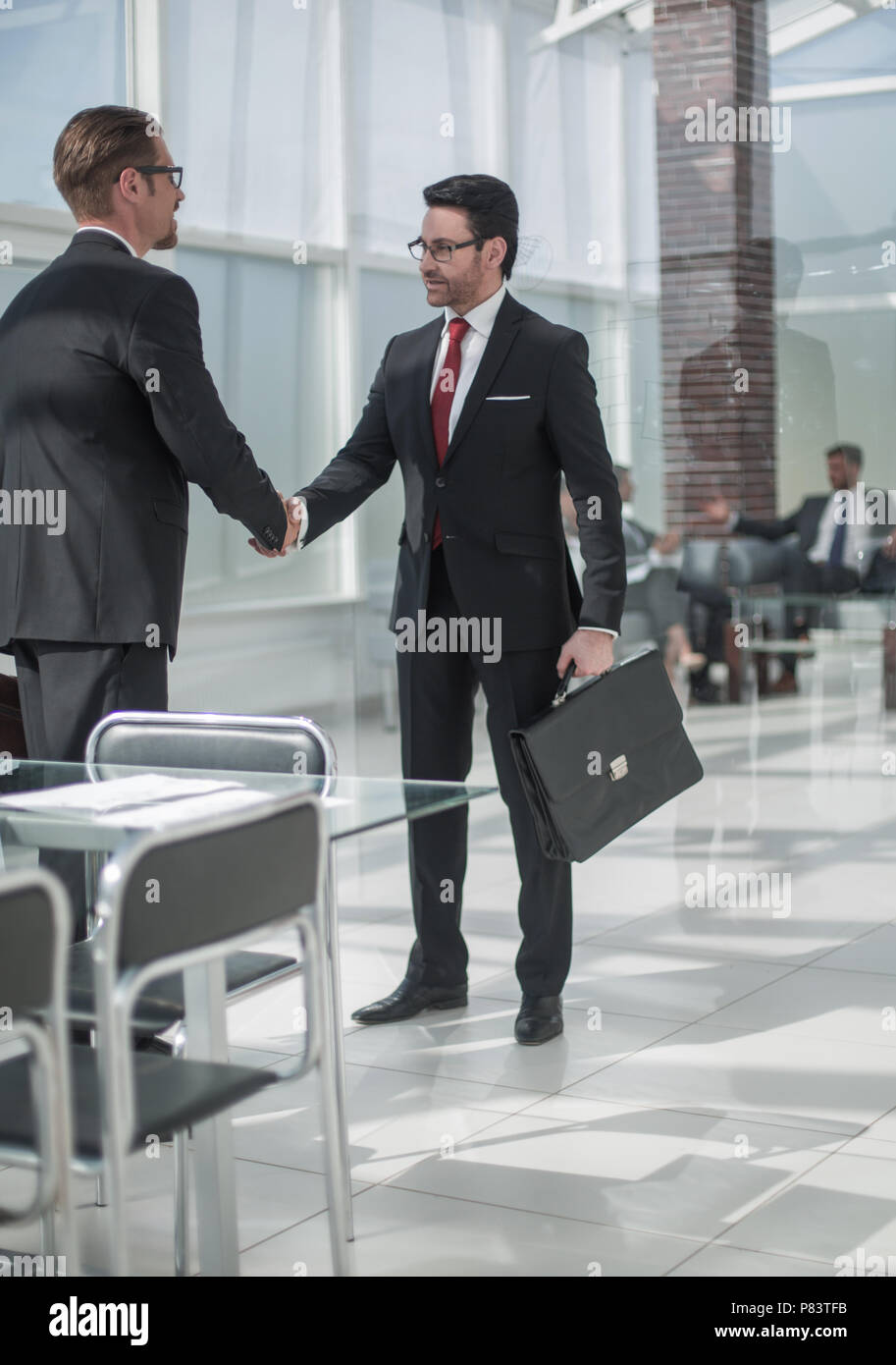 handshake business people in the Bank office - Stock Image
