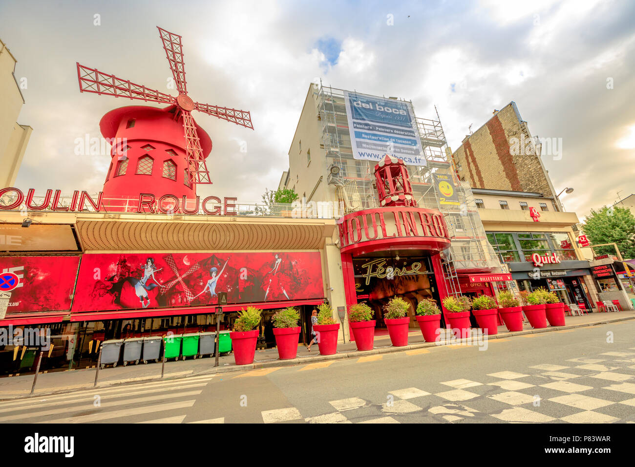 Paris, France - July 1, 2017: Boulevard de la Clichy and nightclub Moulin Rouge in Pigalle red lights district. Most popular historical theater and cabaret attraction of Paris.Tourism in Paris Capital - Stock Image