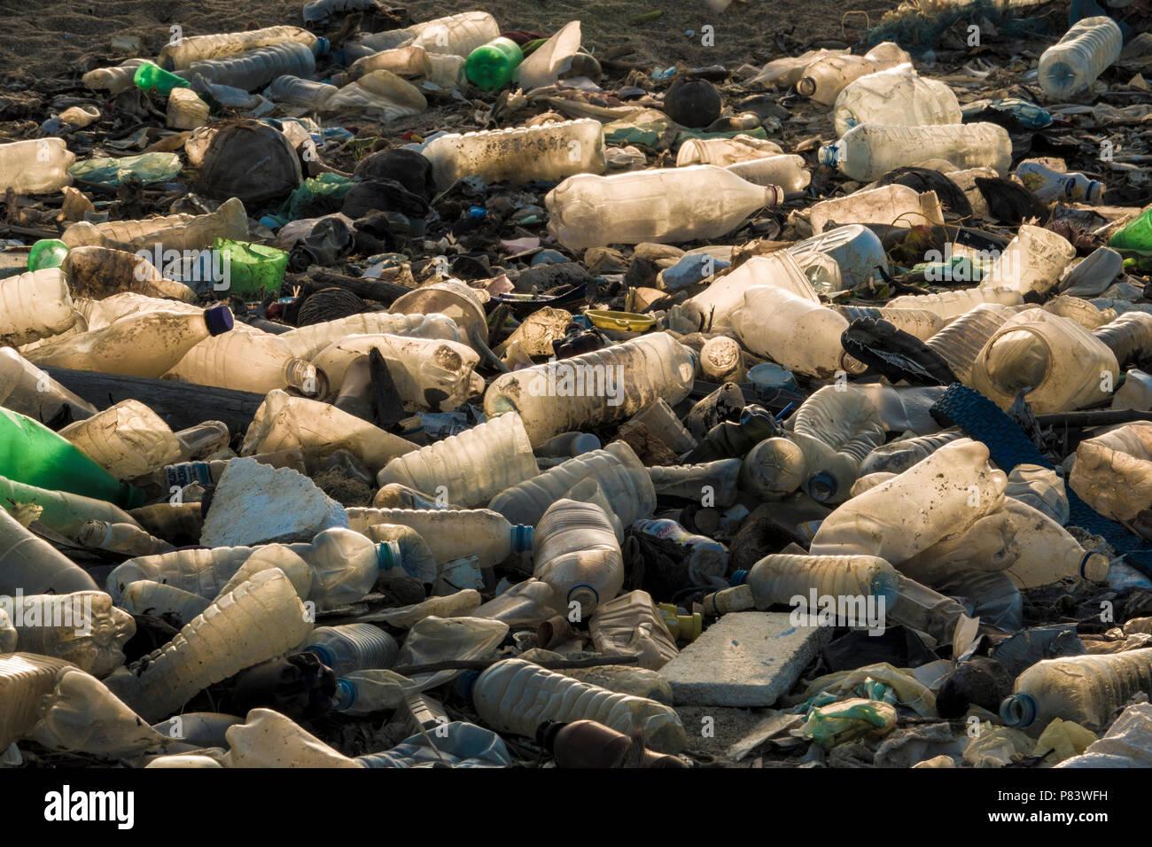 Empty single use plastic drink bottles and other trash on beach in Negombo, Sri Lanka - Stock Image