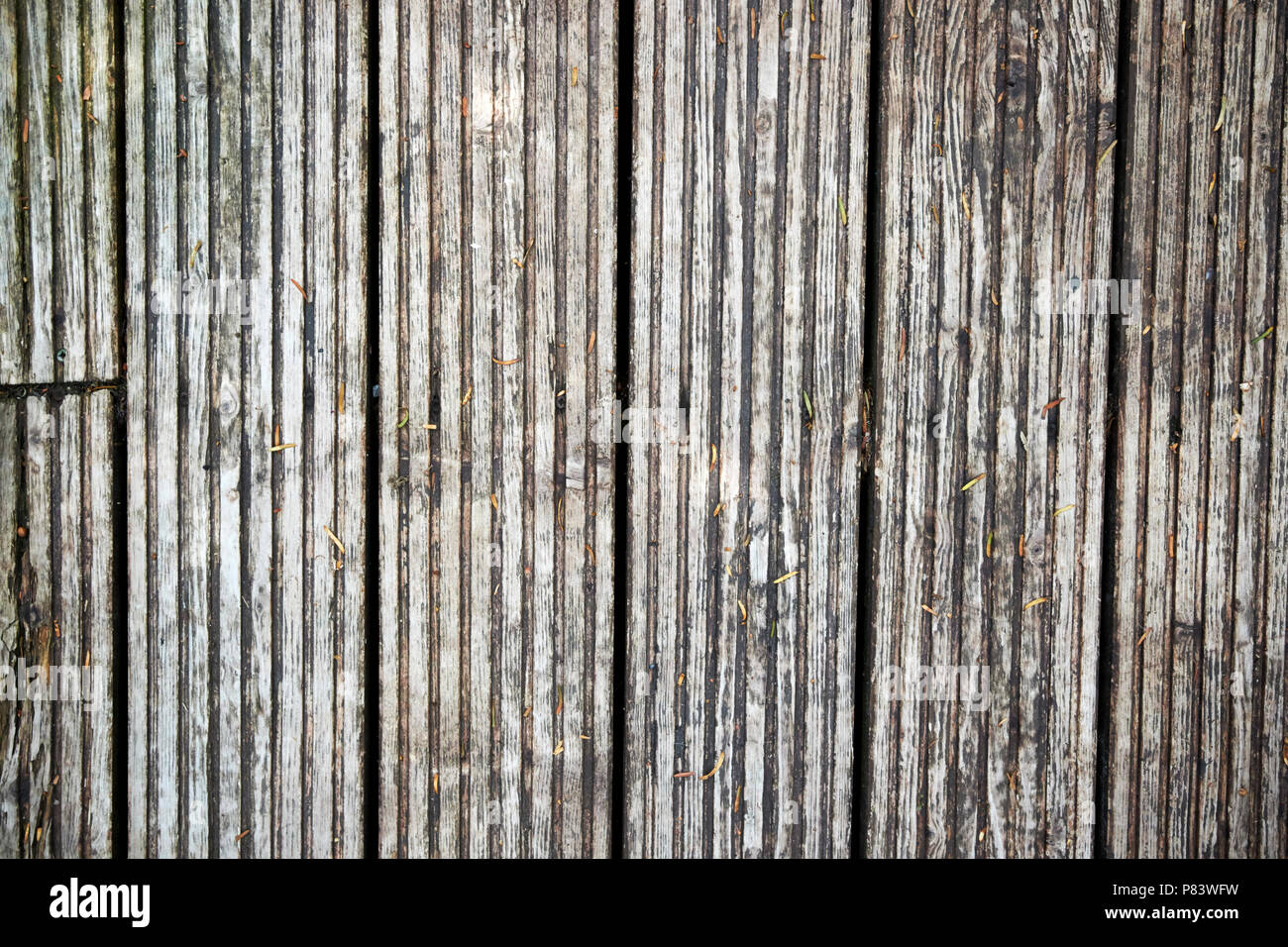 worn weathered wooden decking planks england uk - Stock Image