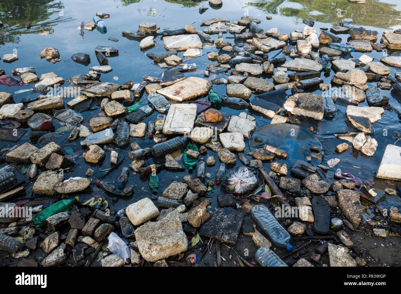 Plastic bottles, polystyrene and other garbage floating in ocean in Negombo, Sri Lanka Stock Photo