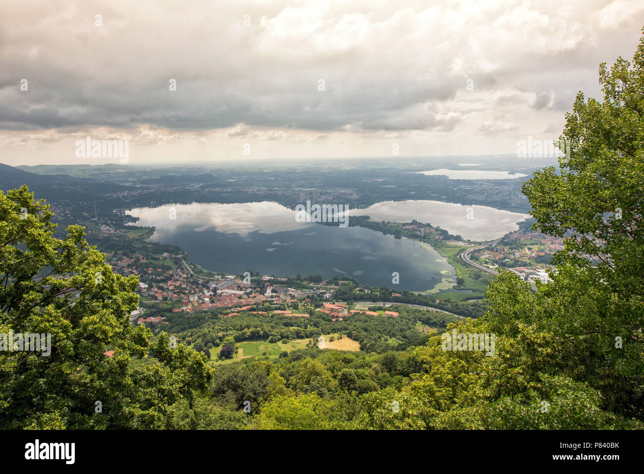 View from the Monte Barro Regional Park near Lecco, Lombardia, Italy of the Italian lake district amidst lush greenery in a scenic landscape - Stock Image