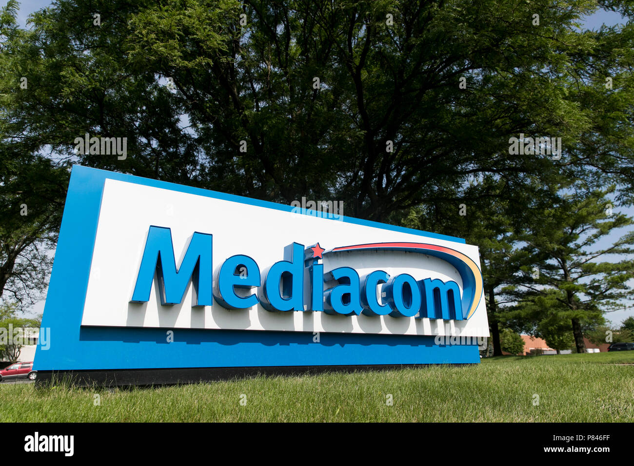A logo sign outside of a facility occupied by Mediacom