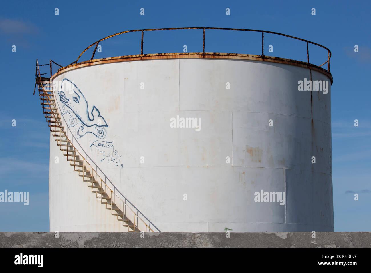 Old WWII water tank on Kanton Island, Kiribati with graffiti - Stock Image