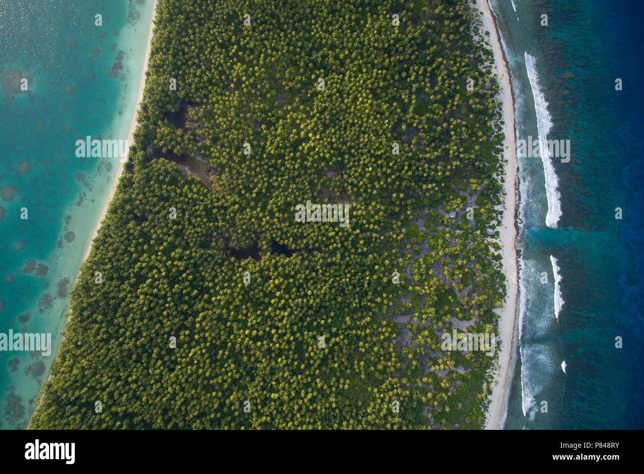 Aerial View of Orona Island, an uninhabited island in the Phoenix Islands, Kiribati. Visible is the lagoon, atoll and Pacific Ocean. - Stock Image