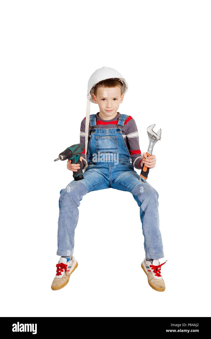 Boy builder helper in helmet - Stock Image