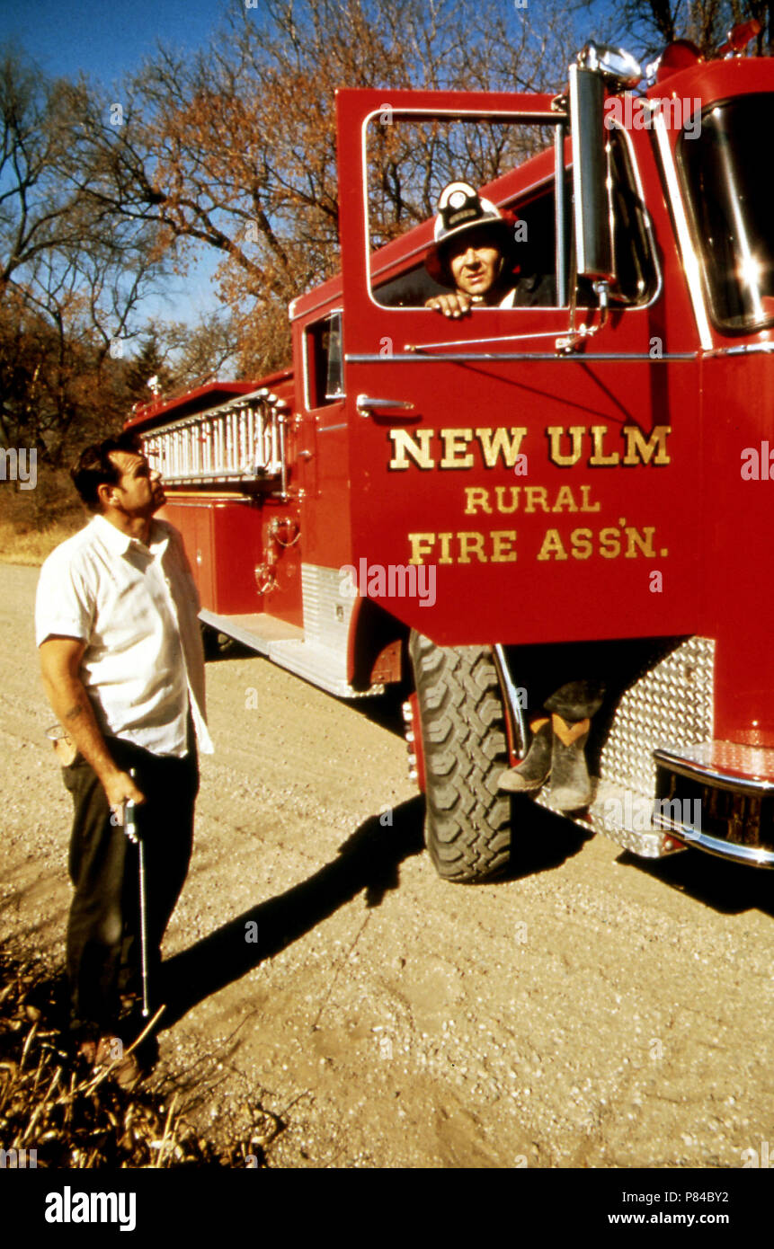 Wallace Whitey Wolf (In Truck) Is a Lieutenant in the Volunteer Fire Department ... October 1974 - Stock Image