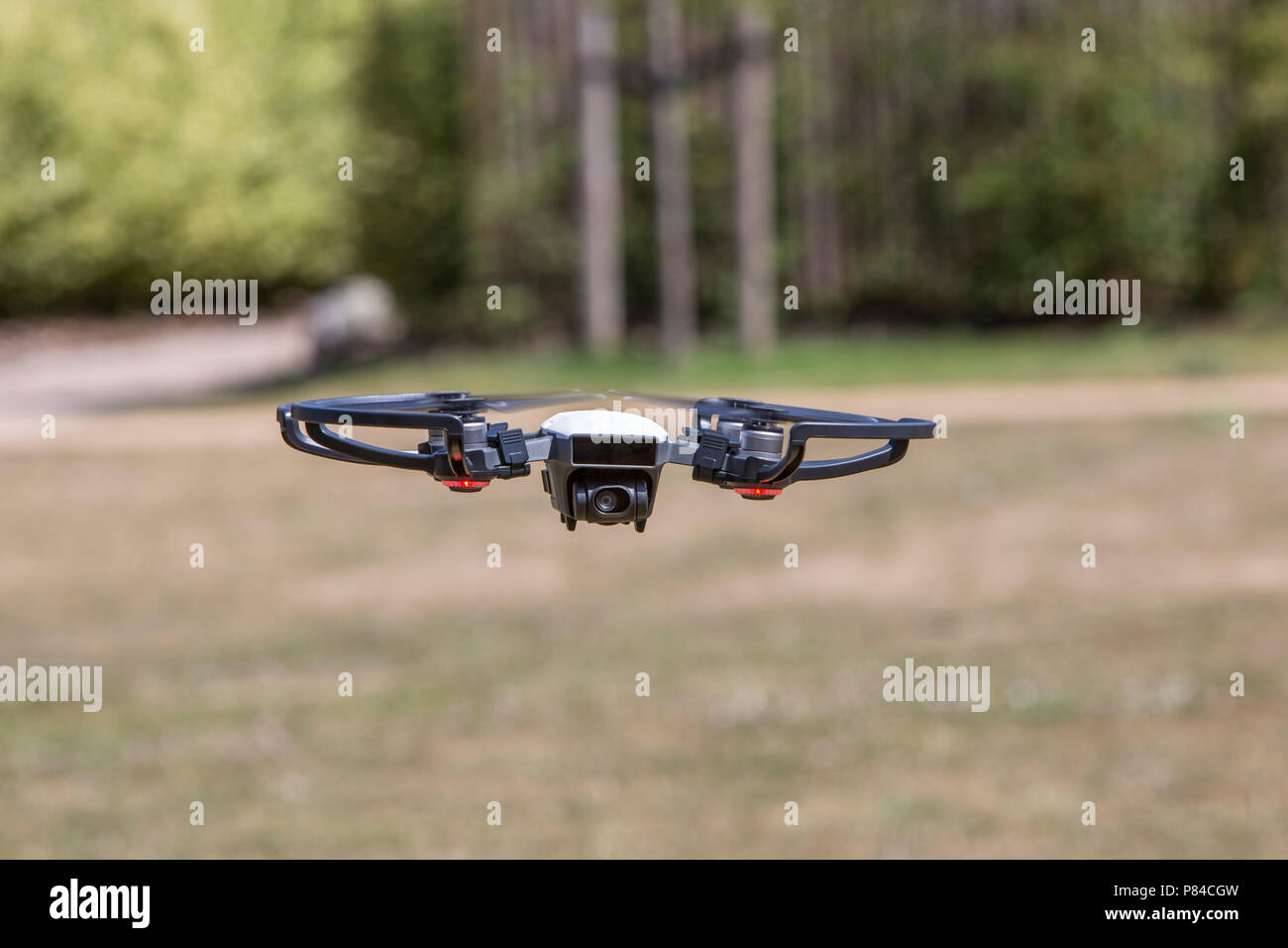A camera carrying drone flying at low level - Stock Image