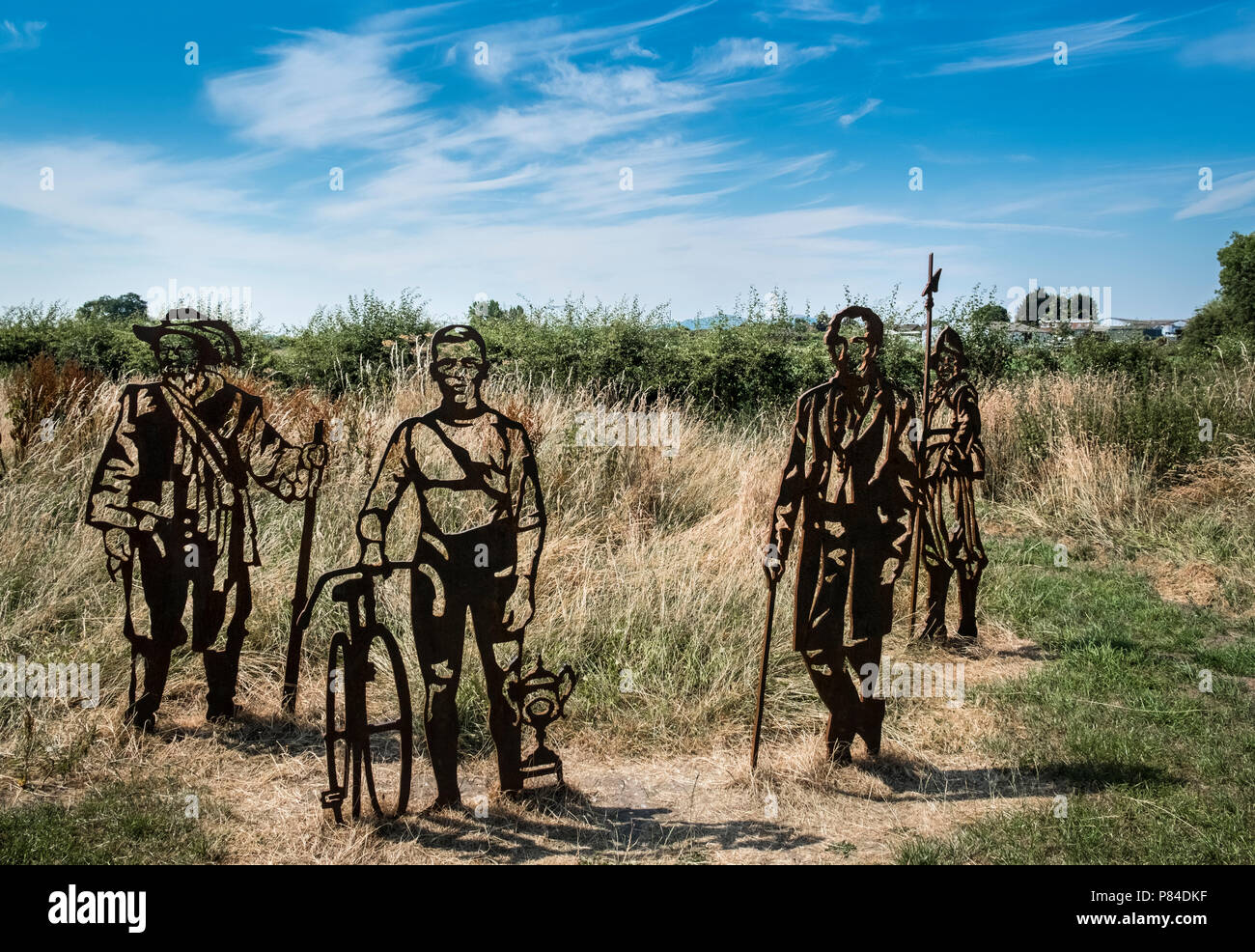 Metal cut outs representing people from Worcesters past displayed on Bromwich Parade walkway near Diglis, Worcestershire, West Midlands UK - Stock Image