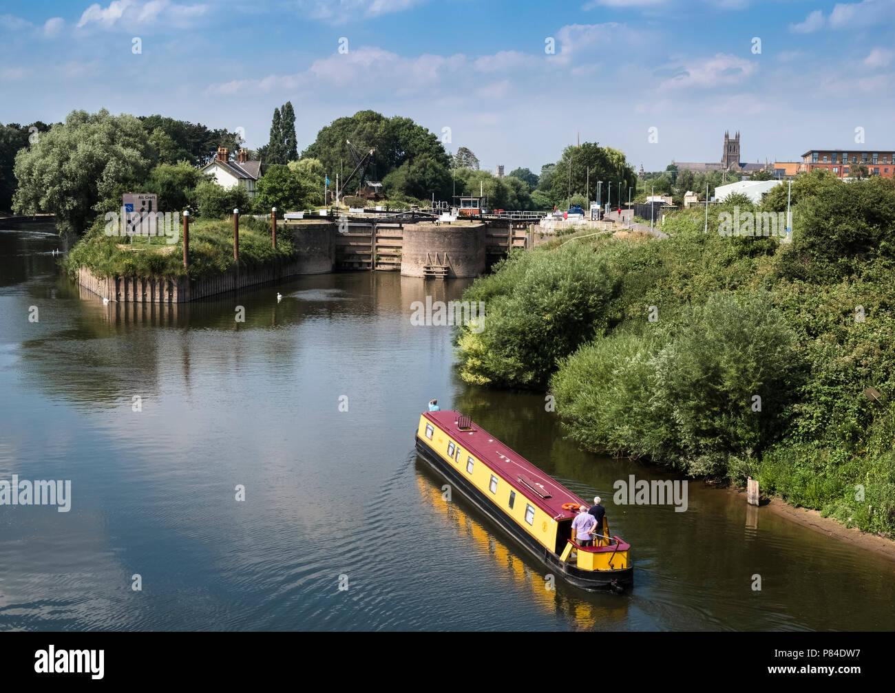 A river barge approaching Diglis River Lock, part of the River Severn Worcester - Birmingham Canal, Worcester, Worcestershire, UK - Stock Image
