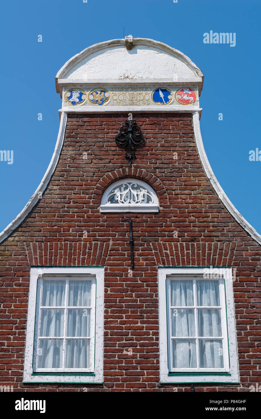 Special gables along the row of habour houses, Sielort Greetsiel, Krummhörn, North Sea, East Frisia, Lower Saxony, Germany Stock Photo