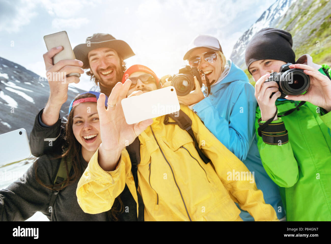Group happy friends tourists photo selfie - Stock Image
