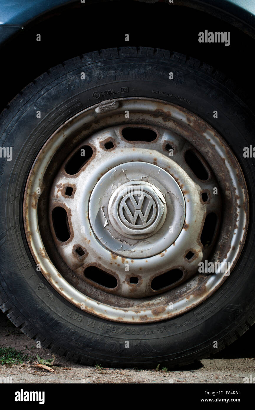 Corroded wheel on a second hand car - Stock Image