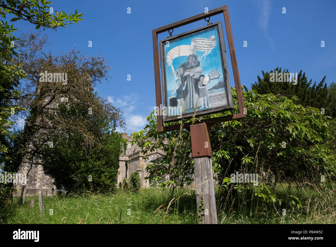 Great Kimble, UK. 6th July, 2018. A sign featuring an image of St Nicholas, patron saint of children, outside St Nicholas Church. - Stock Image